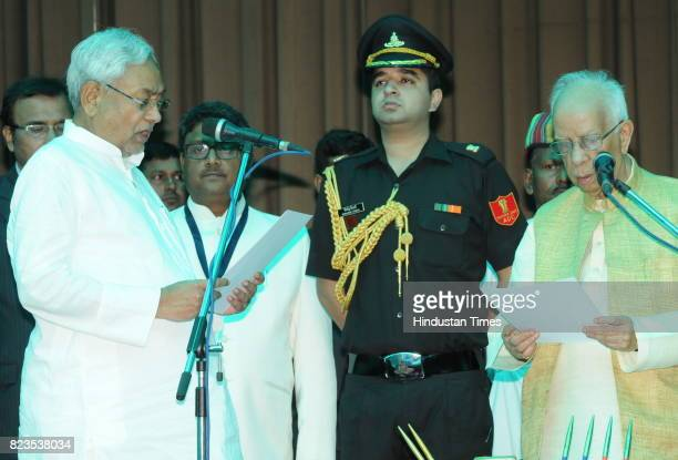 Bihar Governor Keshari Nath Tripathi administers oath to JD President Nitish Kumar as Bihar Chief Minister at Raj Bhawan on July 27 2017 in Patna...
