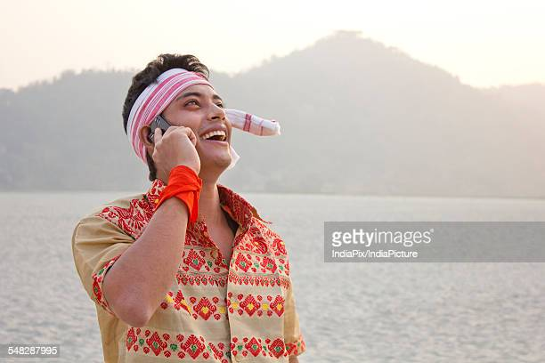 Bihu man talking on a mobile phone