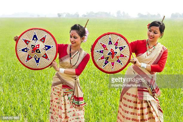Bihu women holding jaapis