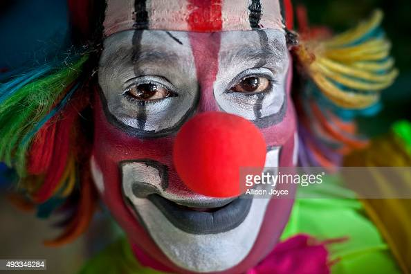Biju the clown poses for a photograph before a performance on October 17 2015 at the Rambo Circus in Pimpri India The Rambo Circus travels throughout...