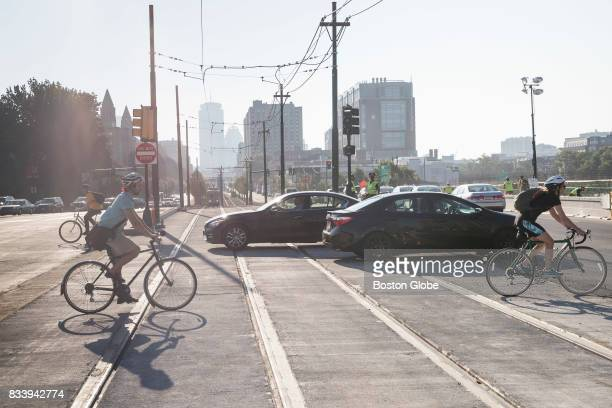 Bike and automobile traffic moves along the Commonwealth Avenue Bridge in Boston as its reopens to traffic on Aug 16 2017 The Commonwealth Avenue and...