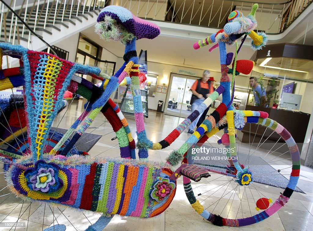 A bike completely coated in knitwear made by amateur artist Martha Schlothmann stands at the city hall of Neukirchen-Vluyn, western Germany, on August 29, 2012. Schlothmann was inpired by the urban street art during a trip to Venezuela and practices urban knitting now on different objects.