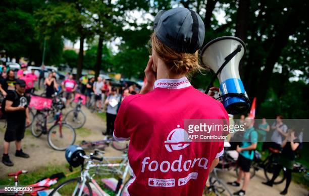 Bike couriers working for Foodora and Deliveroo food delivery companies take to the streets to demonstrate for wage increase in Berlin on June 28...
