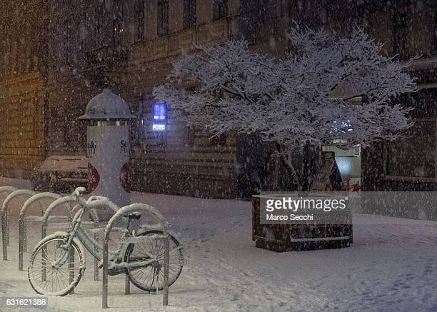 A bike covered with snow stands on January 13 2017 in Ljubljana Slovenia Most of Slovenia was covered by heavy snowfalls for the first time this...