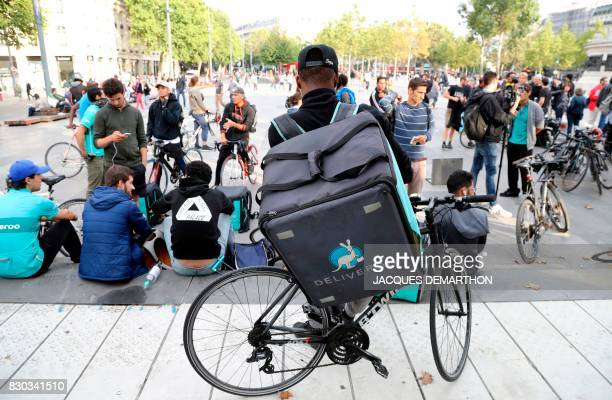 Bike delivery people from the Deliveroo food delivery service demonstrate on August 11 2017 at Place de la Republique in Paris Delivery drivers of...