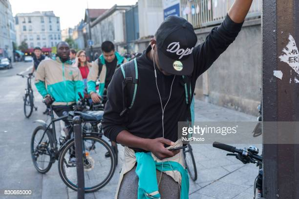 Bike delivery people from the Deliveroo food delivery service demonstrate on August 11 2017 at Place de la Republique in Paris France to demand an...