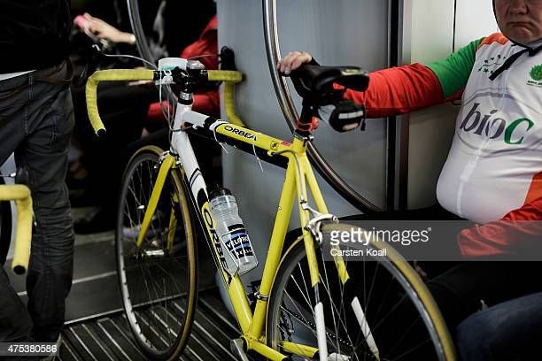 A bike enthusiast transports his bicycle in a train to take part at the 8th Garmin Velothon on May 31 2015 in Berlin Germany Ten thousand bike...