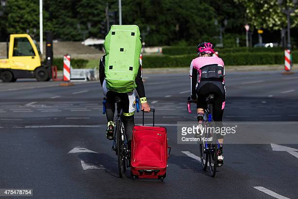 Bike enthusiasts carry their stuff to take part at the 8th Garmin Velothon on May 31 2015 in Berlin Germany 10000 bike enthusiasts drove routes with...