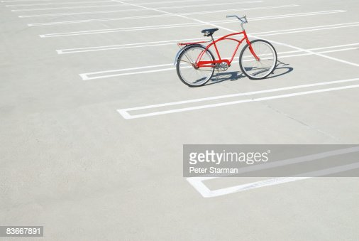 Bike in empty parking lot. : Stock Photo