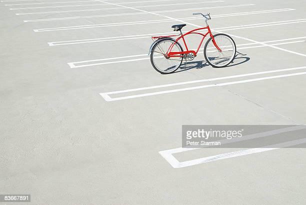 Bike in empty parking lot.