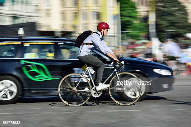 Bike in motion, panning blur in traffic