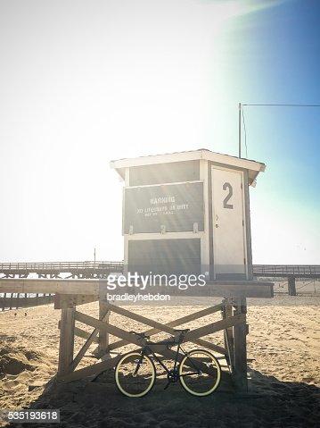 Bike leaning against lifeguard hut on beach