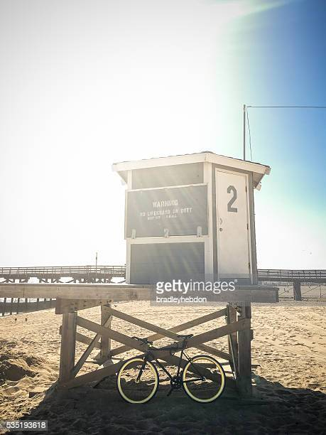 Bike leaning against lifeguard hut on beach