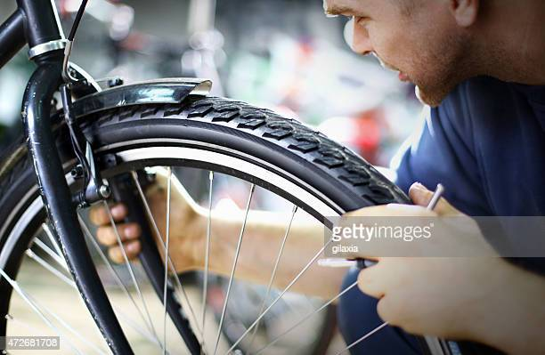 Bike mechanic repairing a wheel