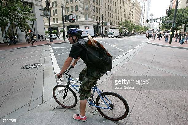 A bike messenger carries a package as he rides down Market Street July 17 2007 in San Francisco CaliforniaWith courts using electronic filing to file...