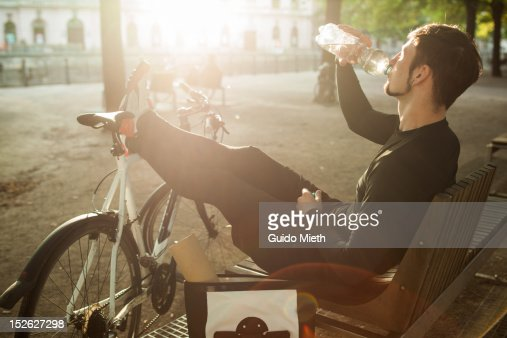 Bike messenger drinking water