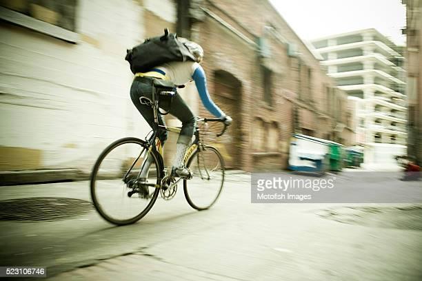 Bike Messenger Racing Down Alley