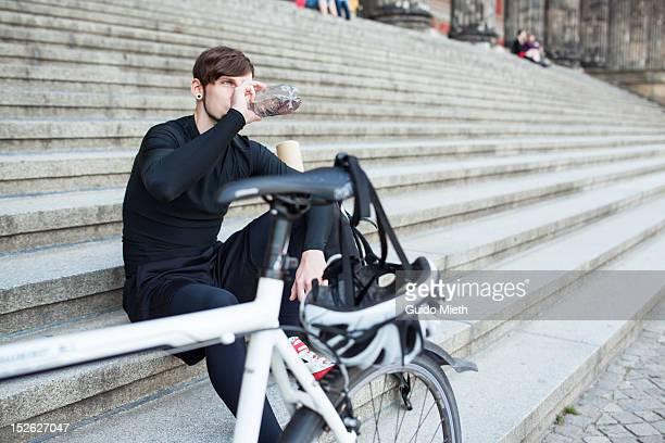 Bike messenger resting