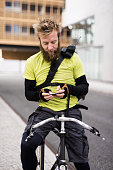 Bike Messenger Texting On Smart Phone