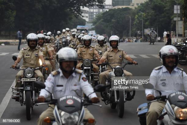 Bike rally by police personnel during 'We Make Pune City Safe' awareness campaign on October 3 2017 in Pune India