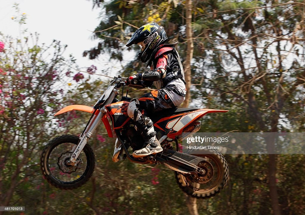 A bike rider participates in the Dirt Biking race, kick started by veteran motocross racer from Mumbai, Rustom Patel in association with the Sports Gurukul Academy at Wadala on March 30, 2014 in Mumbai, India. With total length of 340 metres, the dirt track has four single jumps with some muddy sections.
