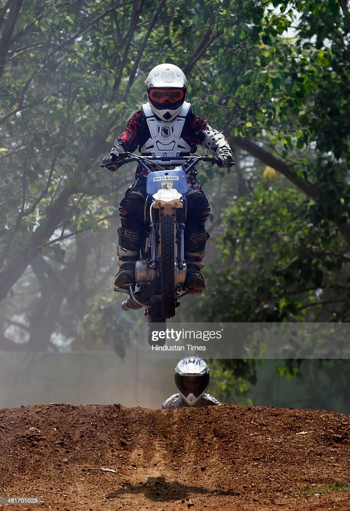Bike riders participate in the Dirt Biking race, kick started by veteran motocross racer from Mumbai, Rustom Patel in association with the Sports Gurukul Academy at Wadala on March 30, 2014 in Mumbai, India. With total length of 340 metres, the dirt track has four single jumps with some muddy sections.