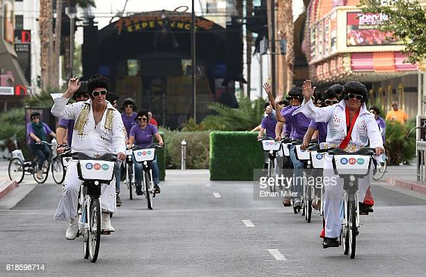 Bike Share general manager Mike Hair and RTC Bike Share project manager Ron Floth ride bicycles dressed as Elvis Presley as they lead a group of bike...