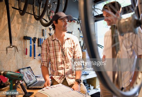 bike shop owner discussing products with client