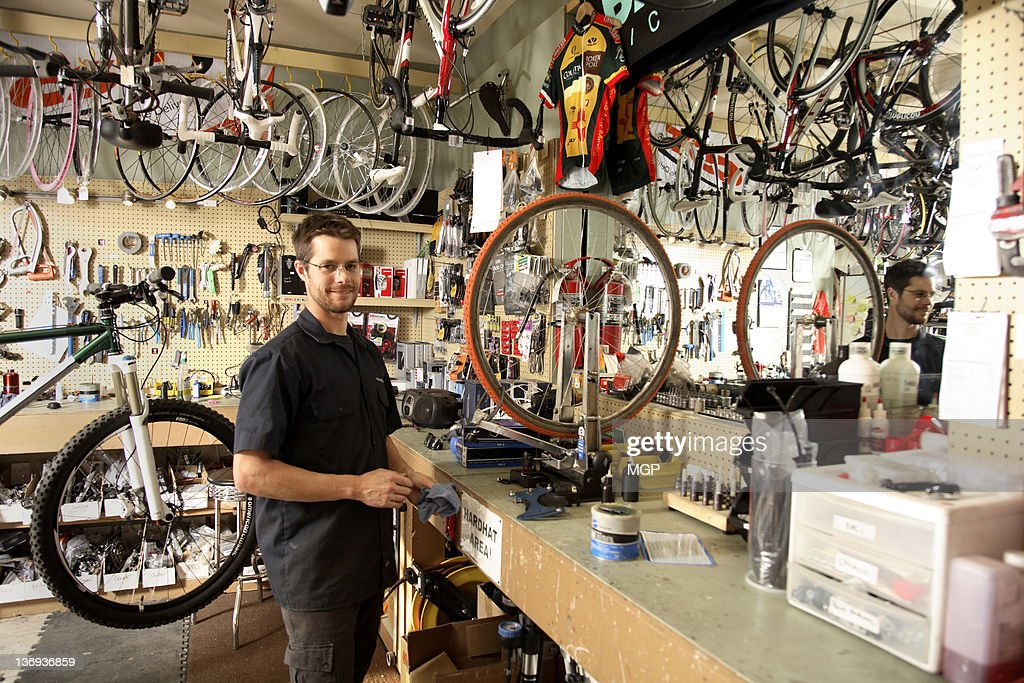 Bike shop owner poses : Stock Photo