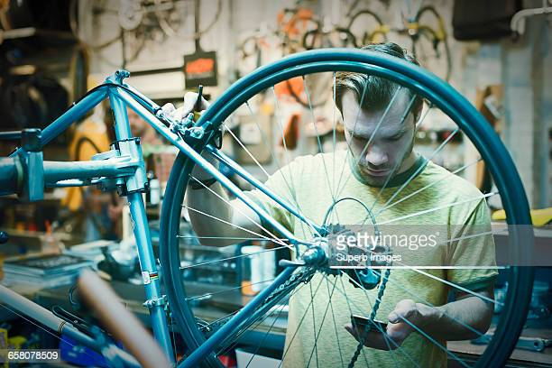 Bike Shop worker checks smartphone