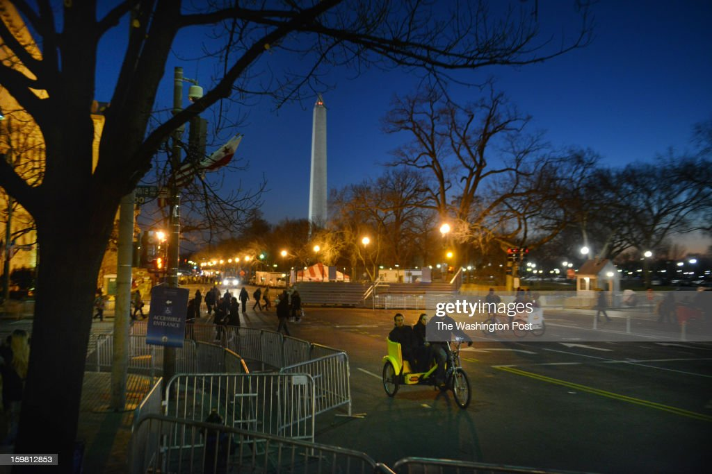 Bike taxis take advantage of the increasing foot traffic as crowds start to gather near the National Mall on the eve of Barack Obama's presidential inauguration on Sunday, January 20, 2012, in Washington, DC.