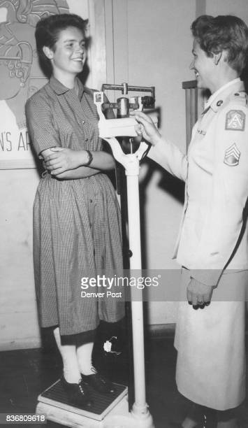 Bike Tourist Joins WAC Wanda Wixom of ChelseaonHudson N Y weighs in at a trim 133 pounds at the US Army Recruiting Station in the Old Customs house...
