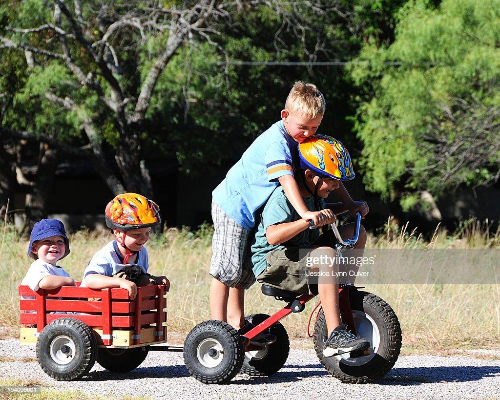 Bike Wagon Full of Brothers : Stock Photo