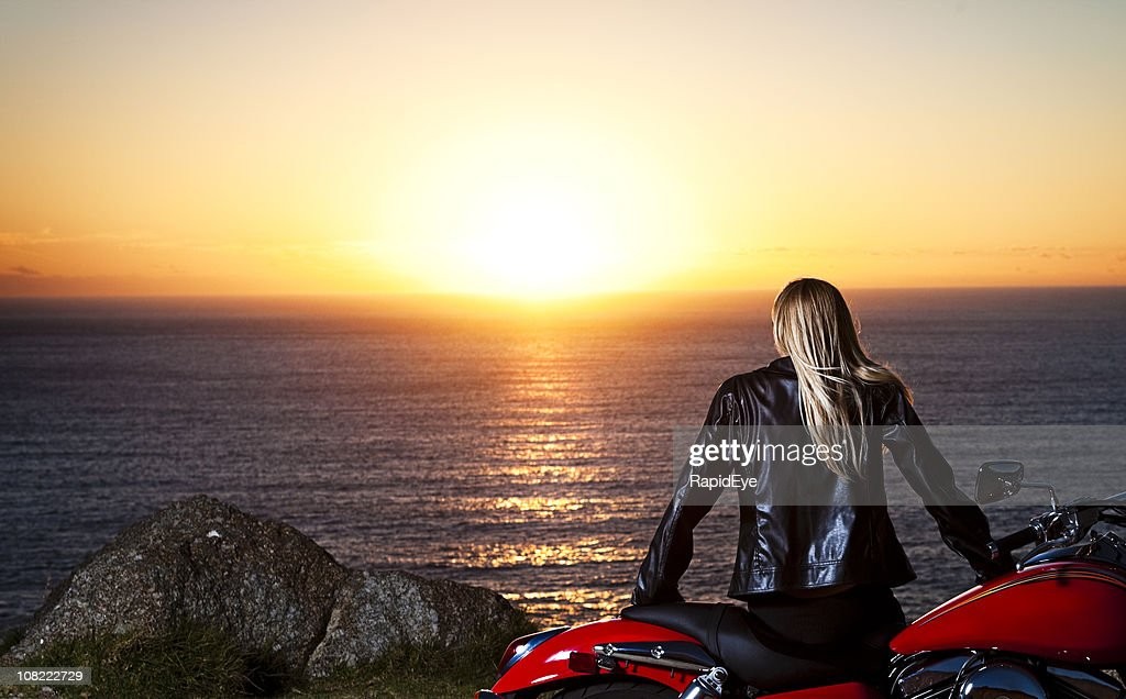 Biker babe watching sunset