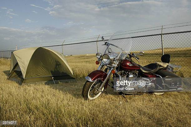 A biker camps outside Sturgis South Dakota during the annual Sturgis Motorcycle Rally August 6 2003 The weeklong rally attracts an estimated 500000...