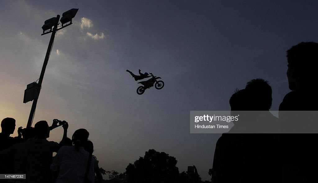 A biker does a stunt during Red Bull X-Fighters Freestyle Motocross (FMX) motorbike stunt competition on June 30, 2012 in New Delhi, India.