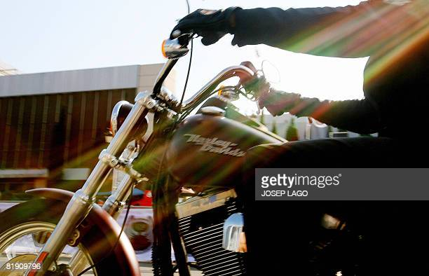 A biker rides his Harley Davidson on Maria Cristina street in Barcelona during the HarleyDavidson 105th Anniversary Open Road Tour celebrated over...