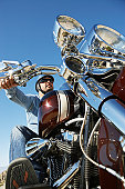 Biker riding motorcycle, low angle view