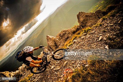 Biker Riding on a Mountain Trail