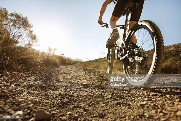 Biker riding on single track trail