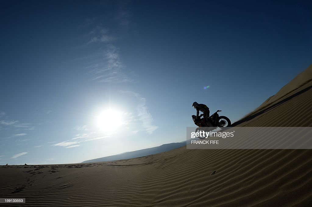 KTM biker Ruben Faria competes during Stage 4 of the Dakar 2013 between Nazca and Arequipa, Peru, on January 8, 2013. The rally will take place in Peru, Argentina and Chile from January 5 to 20. AFP PHOTO/Franck Fife