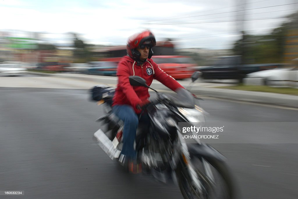A biker takes part in the 'Caravana del Zorro' (Fox Caravan), going from Constitution Square in Guatemala City towards Esquipulas, 220km eastward, on February 2, 2013. Some 35,000 motorcyclists marched in a pilgrimage to the Cristo Negro (Black Christ) basilic, an already 52-year-old tradition that was declared as Nation heritage. AFP PHOTO/Johan ORDONEZ