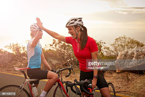 Bikeriders & training partners doing high-five