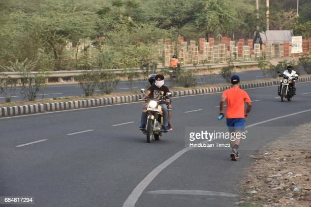 Bikers and runners on Gurgaon Faridabad Road on May 14 2017 in Gurgaon India GurgaonFaridabad Expressway is one of most popular Biking Trails amongst...