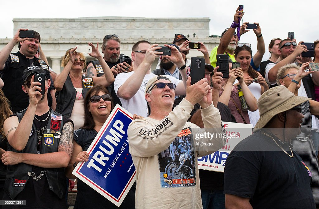 STATES - MAY 29 - Bikers and supporters cheer as Republican presidential candidate Donald Trump speaks on the National Mall during the Rolling Thunder Inc. XXIX 'Freedom Ride,' on Sunday, May 29, 2016 in Washington. The annual bike ride which occurs over Memorial Day weekend, honors U.S. prisoners of war and missing-in-action troops, as well as raises awareness about veterans issues.