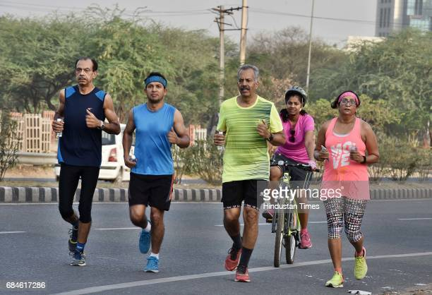 Bikers cyclists and runners in Gurgaon Faridabad Road on May 14 2017 in Gurgaon India GurgaonFaridabad Expressway is one of most popular Biking...