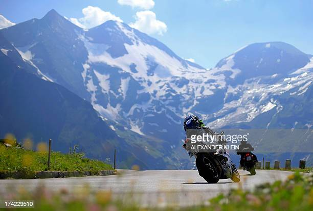 Bikers enjoy a ride on the Grossglockner high alpine road in the mountains of the Hohe Tauern near Zell am See on July 21 2013 The famous 48...