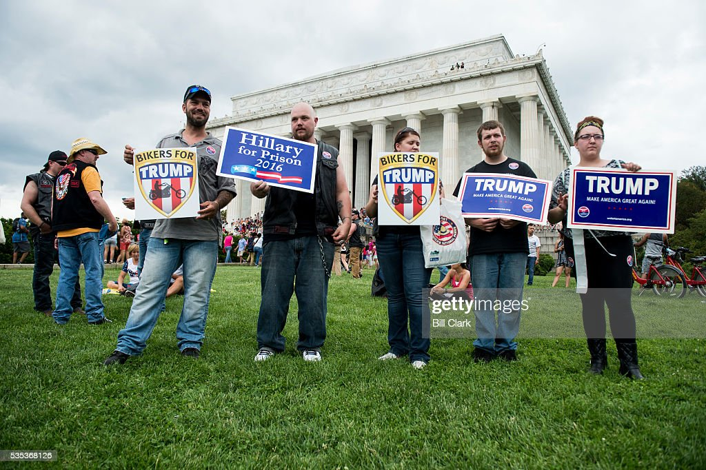 Bikers for Trump hold up signs as they wait for presidential candidate Donald Trump to speak to the Rolling Thunder bikers at the Lincoln Memorial during the annual Memorial Day Rolling Thunder ride in Washington on Sunday, May 29, 2016.