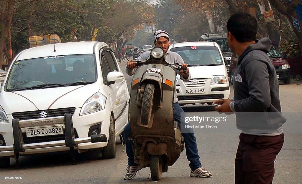 Bikers performed dangerous stunts at Rajendra Nagar road in Shaibabad area on February 3, 2013 in Ghaziabad, India. Commuters faced tough time while crossing through the area.