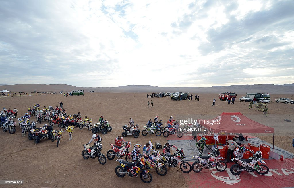 Bikers queue for gas before the start of Stage 6 of the 2013 Dakar Rally between Arica and Calama, Chile, on January 10, 2013. The rally is taking place in Peru, Argentina and Chile from January 5 to 20.